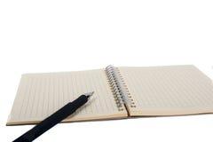 Pluma del cuaderno espiral y del pollpoint Imagen de archivo libre de regalías