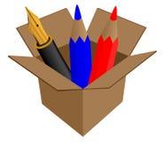 Pluma en caja de cartón Foto de archivo libre de regalías