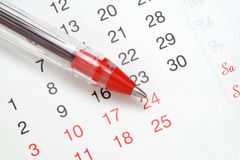 Pluma en calendario Fotografía de archivo libre de regalías