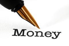 Pluma en el texto del dinero Imagen de archivo libre de regalías