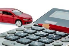 Pluma y calculadora autos, rojas Fotos de archivo libres de regalías