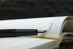 Pluma y cuaderno Fotografía de archivo libre de regalías