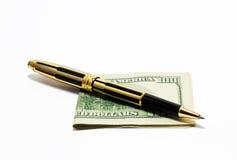 Pluma y dinero Imagen de archivo libre de regalías