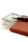 Pluma y dinero Foto de archivo libre de regalías