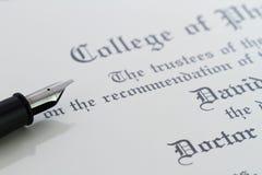 Pluma y diploma Imagen de archivo libre de regalías