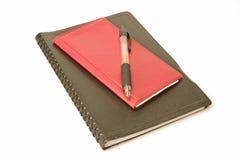 Pluma y direccionamiento del libro de verificación Fotografía de archivo libre de regalías