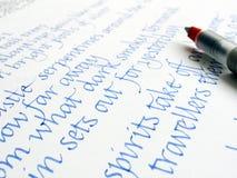Pluma y escritura de la caligrafía Foto de archivo libre de regalías