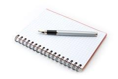 Pluma y escritura-libro Imágenes de archivo libres de regalías