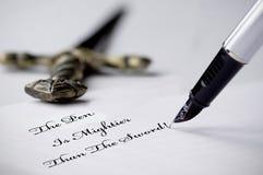 Pluma y espada Fotografía de archivo libre de regalías