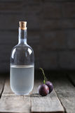 Plumb brandy, Romanian tuica. Made of plums Royalty Free Stock Images