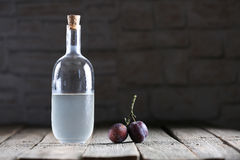 Plumb brandy, Romanian tuica. Made of plums Royalty Free Stock Photography