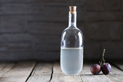 Plumb brandy, Romanian tuica. Made of plums Stock Photo