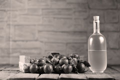 Plumb brandy, Romanian tuica. Plumb brandy, Romanian tsuica made of plums Stock Image