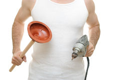 Plumber. Carpenter holding a plunger and an electric drill Royalty Free Stock Photography