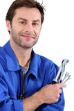 Plumber. Male plumber holding replacemant part Royalty Free Stock Photo