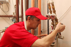 Plumber. View of a plumber repairing a faucet Stock Photography