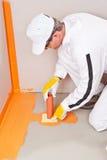 Plumber apply waterproofing cuff. Plumber applied waterproofing cuff on the floor of the bathroom Royalty Free Stock Image