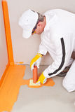 Plumber apply waterproofing cuff. Plumber applied waterproofing cuff on the floor of the bathroom Stock Images
