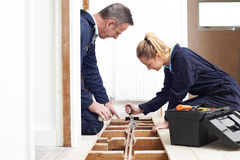 Plumber And Apprentice Fitting Central Heating Stock Photos