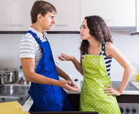 Plumber asking furious young woman for bribes indoors Royalty Free Stock Photos