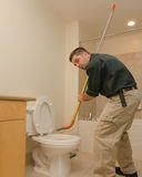 Plumber with auger Royalty Free Stock Photo