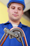 Plumber bending copper pipe Stock Photos