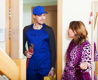 Plumber came to young woman Royalty Free Stock Photography