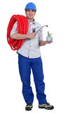 Plumber carrying hose Royalty Free Stock Image