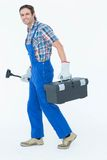 Plumber carrying plunger and tool box. Full length portrait of plumber carrying plunger and tool box over white background Royalty Free Stock Images