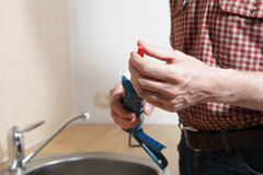 Plumber with caulking gun Royalty Free Stock Photography
