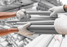 Plumber choose PVC pipes from bundle Royalty Free Stock Photography