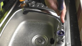 Plumber completed changing sink tap valve stock video