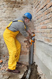 Plumber at construction site installing sewerage tube Royalty Free Stock Photos