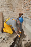 Plumber at construction site installing sewerage tube Royalty Free Stock Photography