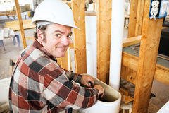 Plumber on Construction Site Royalty Free Stock Photos