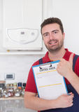Plumber  control check on the home water boiler Stock Photos