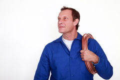 Plumber with copper pipe Stock Images