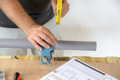 A plumber cut PVC pipe Royalty Free Stock Images