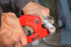 Plumber Cuts The Ppr Pipe Using A Cutter. Stock Images