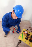 Plumber cutting copper pipe Stock Photos