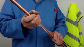 Plumber cutting a copper pipe with a pipe cutter stock video