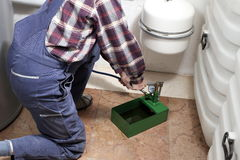 Plumber is filling up Royalty Free Stock Photography