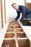 Plumber Fitting Central Heating System In House. Plumber Fits Central Heating System In House stock images