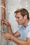 Plumber Fitting Pipes On Construction Site Royalty Free Stock Photography
