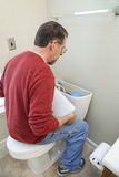 Plumber fixing bathoom water leak Royalty Free Stock Photos