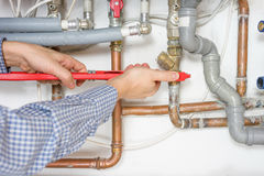 Plumber fixing central heating system Stock Image