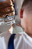 Plumber fixing gas water heater Stock Photos