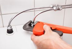 Plumber Fixing Household Fixture Royalty Free Stock Photos