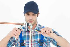 Plumber fixing pipe over white background Royalty Free Stock Photography