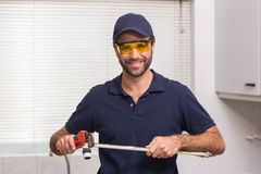 Plumber fixing pipe with wrench Stock Photography